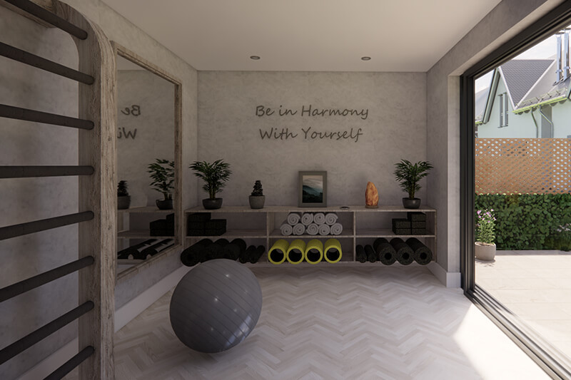 Inside NUA 25, shelves with yoga mats on the back wall, exercise ball in the middle of the room